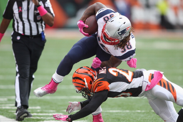 CINCINNATI, OH - OCTOBER 06:  Terence Newman #23 of the Cincinnati Bengals tackles Brandon Bolden #38 of the New England Patriots during their game at Paul Brown Stadium on October 6, 2013 in Cincinnati, Ohio.  The Bengals defeated the Patriots 13-6.  (Photo by John Grieshop/Getty Images)