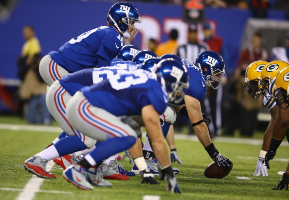 EAST RUTHERFORD, NJ - NOVEMBER 17: Eli Manning #10 of the New York Giants in action against the Green Bay Packers during their game at MetLife Stadium on November 17, 2013 in East Rutherford, New Jersey. (Photo by Al Bello/Getty Images)
