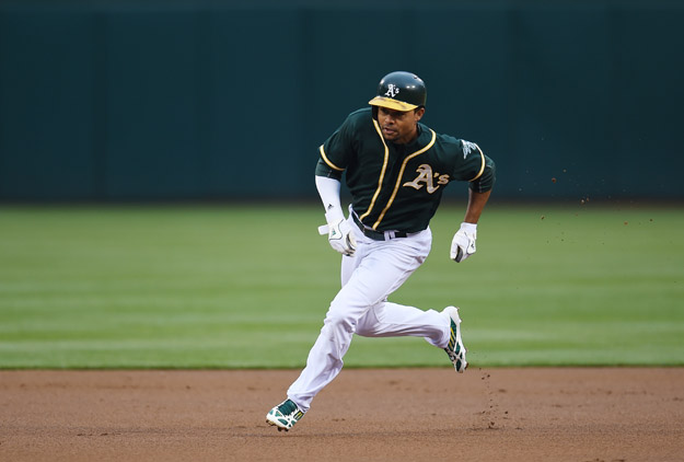 OAKLAND, CA - MAY 30:  Coco Crisp #4 of the Oakland Athletics runs the bases against the Los Angeles Angeles of Anaheim in the bottom of the first inning at O.co Coliseum on May 30, 2014 in Oakland, California.