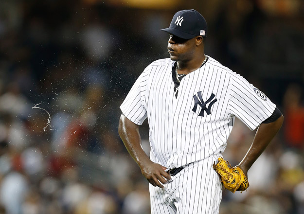 NEW YORK, NY - SEPTEMBER 11:  Michael Pineda #35 of the New York Yankees reacts after Yunel Escobar #11 of the Tampa Bay Rays hits a three run home run in the fourth inning at Yankee Stadium on September 11, 2014 in the Bronx borough of New York City.